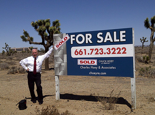 Chuck with sold sign